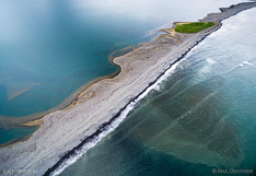 Barrier island between the sea and lagoon in northern Iceland. Aerial photo captured with a camera drone (Phantom).