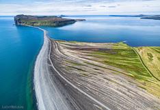 Lagoon in northern Iceland with the island Þórðarhöfði in Skagafjörður. Aerial photo captured with a camera drone (Phantom).