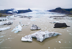 Floating icebergs in Fjallsárlón glacier lake in front of the Fjallsjökull glacier tongue in Iceland. Aerial photo captured with a camera drone (Phantom) by Paul Oostveen.
