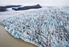 Glacier tongue Fjallsjökull at the edge of glacier lake Fjallsárlón in Iceland. Aerial photo captured with a camera drone by Paul Oostveen.