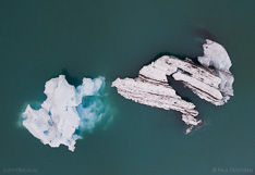 Floating icebergs in Jökulsárlón glacier lagoon in Iceland. Aerial photo captured with a camera drone (Phantom) by Paul Oostveen.