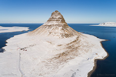 Snow-covered Kirkjufell in winter. Aerial photo captured with a camera drone (Phantom) by Paul Oostveen.