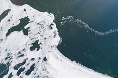 Frozen lake in Iceland in winter. Aerial photo captured with a camera drone (Phantom) by Paul Oostveen.