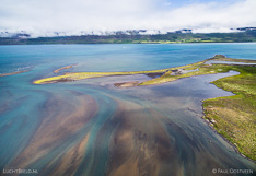 River flows into fjord Eyjafjörður in northern Iceland. Aerial photo captured with a camera drone (Phantom).