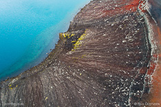 Edge of the Bláhylur crater lake in Fjallabak in Iceland. Aerial photo captured by drone.