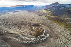 Lava field with fissure from the 1970 eruption of Hekla volcano in Iceland. Aerial photo captured by drone.