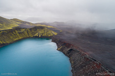 Rainshowers approaching Bláhylur crater lake in Fjallabak in Iceland. Aerial photo captured by drone.