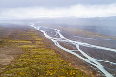 Rainshowers over Jokulfall (Jokulvisl) river in Kjölur in the highlands of Iceland. Aerial photo captured by drone.