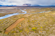 Svarta river and Kjalfell mountain with rain showers in Kjölur in the highlands of Iceland. Aerial photo captured by drone.