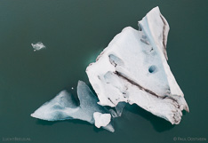 Floating iceberg in Jökulsárlón glacier lagoon in Iceland. Aerial photo captured with a camera drone (Phantom) by Paul Oostveen.