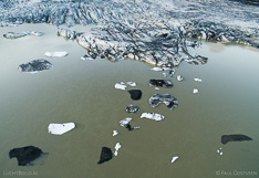 Floating icebergs in front of the glacier tongue Skaftafellsjökull in Iceland. Aerial photo captured with a camera drone (Phantom) by Paul Oostveen.