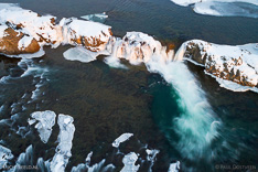 Tröllafossar waterfalls in Iceland in the winter. Long exposure aerial photo captured with a camera drone (Phantom) with aid of a ND16 filter. Tröllafossar means waterfalls of the trolls. Photographer: Paul Oostveen.