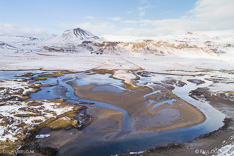Estuary at Búðir on Snæfellsnes in winter with snow. Aerial photo captured with a camera drone (Phantom) by Paul Oostveen.