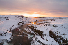 Sunset above waterfall Tröllafossar in Iceland in winter. Aerial photo captured with a camera drone (Phantom) by Paul Oostveen.