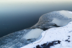 Frozen lake in winter in Iceland. Aerial photo captured with a camera drone (Phantom) by Paul Oostveen.